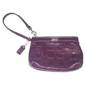 COACH eggplant patent leather monogram wristlet